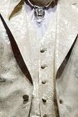 MOSCOW - NOVEMBER 4: Details of golden men vest and jacket on show of designer Slava Zaitsev in fash