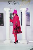 MOSCOW - NOVEMBER 4: Model in pink coat on show of designer Slava Zaitsev in fashion house of Slava