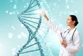 stock photo of biotech  - Image of DNA strand against colour background - JPG