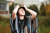 Young rastafarian man in a city park