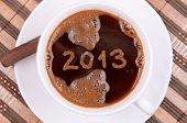 New year 2013 handwritten on the coffee surface in the cup, with coffee foam texture
