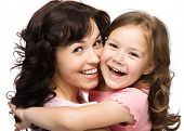 Portrait of happy daughter and her mother, isolated over white