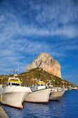 Calpe in alicante with Penon Ifach mountain and marina boats