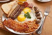 stock photo of sausage  - traditional english breakfast  - JPG