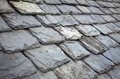 Aged slate roof tiles close-up