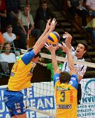 KAPOSVAR, HUNGARY - OCTOBER 5: Andras Geiger (white 7) in action at a Middle European League volleyb