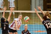 KAPOSVAR, HUNGARY - OCTOBER 7: Zsanett Pinter (in white) in action at the Hungarian I. League volley