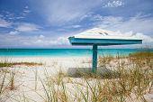 Wooden sun shade on a on stunning Caribbean beach
