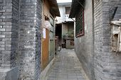 old Manchurian styled buildings and alley ways of over 200 years old in hutong area of Beijing, Chin