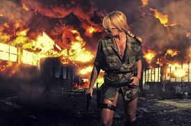 picture of gunshot  - special  tactics sexy woman holding up her weapon with explosion behind her - JPG