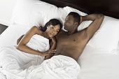 Elevated view of an African American couple lying in bed