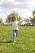 Young Girl Running With Open Arms