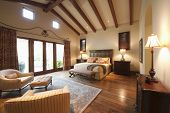 stock photo of master bedroom  - Spacious bedroom with beamed wooden ceiling - JPG
