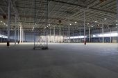 stock photo of scaffold  - Large empty warehouse with scaffold - JPG