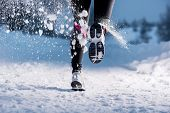 stock photo of shoe  - Athlete woman is running during winter training outside in cold snow weather - JPG