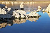 Extremely beautiful landscape. Mono Lake on a sunset. Lake stalagmites of the Tufa are reflected in smooth water of lake