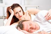stock photo of adultery  - woman sleeping next to her husband in bed - JPG