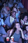 Group of multiethnic people watching a boring movie