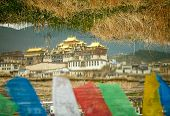 Landscape with tibetan monastery reflected in the lake
