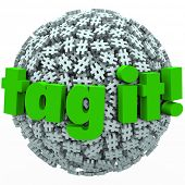 The words Tag It on a ball or sphere of hash tags to illustrate trending topics, posts or stories pr