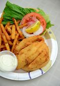 stock photo of hogfish  - fried fish sandwich and french fries on a plate - JPG