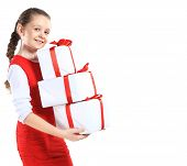 Portrait of happy little girl with gift boxes over white background