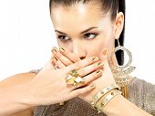 image of minx  - Pretty woman with golden nails and beautiful gold jewelry isolated on white background - JPG