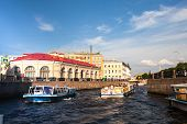 ST.PETERSBURG, RUSSIA - JUNE 24: On boat along channels city, June 24, 2013, SPb, Russia. In the city there are many, of not less than 93-x rivers, sleeves, ducts, channels, a total length of 300 km.