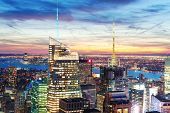stock photo of penthouse  - New York City skyline aerial view at dusk with skyscrapers of midtown Manhattan - JPG