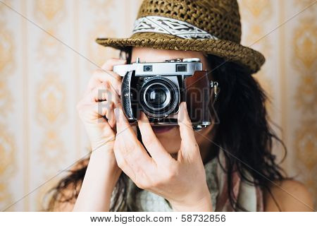 Female Hipster Taking Photo With Retro Camera poster