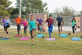 stock photo of lady boots  - Mixed group of mature adults in boot camp exercise - JPG