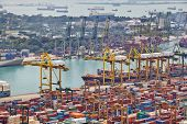 SINGAPORE - DECEMBER 07: The port of Singapore on December 07, 2013 in Singapore. It's the world's busiest transshipment port and the world's second-busiest port in terms of total shipping tonnage.