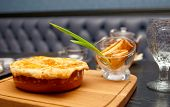 Meat pie on table in pub, men's food