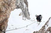 Alpinist climbing ferrata La torre di Toblin (2.617 m), Dolomites, Italy, Europe