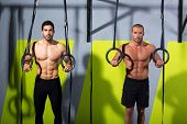 Crossfit dip ring two men workout at gym dipping exercise