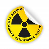 foto of radioactive  - yellow bent sticker with black radioactive sign - JPG