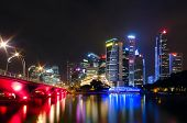 stock photo of singapore night  - The view across the bay to the Singapore night bridge skyscrapers and bright lights - JPG