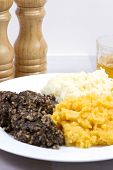 stock photo of haggis  - A traditional Scottish Haggis with potatoes and swede - JPG