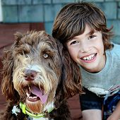 Young boy with Pet Dog closeup