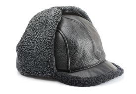 stock photo of budge  - Mens winter cap isolated on white - JPG