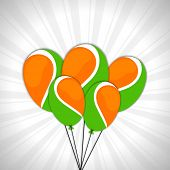 Glossy balloon in national tricolors on grey rays background for Indian Independence Day celebration