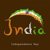 Stylish text India in national tricolors on brown background for Indian Independence Day celebration