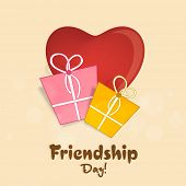 Happy Friendship Day celebrations with gift boxes on red heart decorated on beige background.