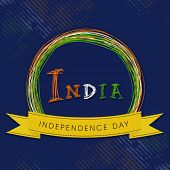 Colorful text India in a badge with yellow ribbon on blue background for Indian Independence Day cel