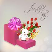 Happy Friendship Day celebrations concept with gift boxes, teddy bear and roses bouquet on shiny gre