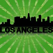 Los Angeles skyline reflected with green dollars sunburst illustration