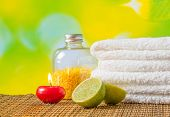 Spa Massage Border Background With Towel Stacked,red Candle And Lime