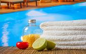 Spa Massage Border Background With Towel Stacked,red Candle And Lime Near Swimming Pool