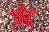 Colorful peppercorn background with red star