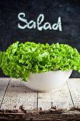 fresh salad on metal bowl and blackboard